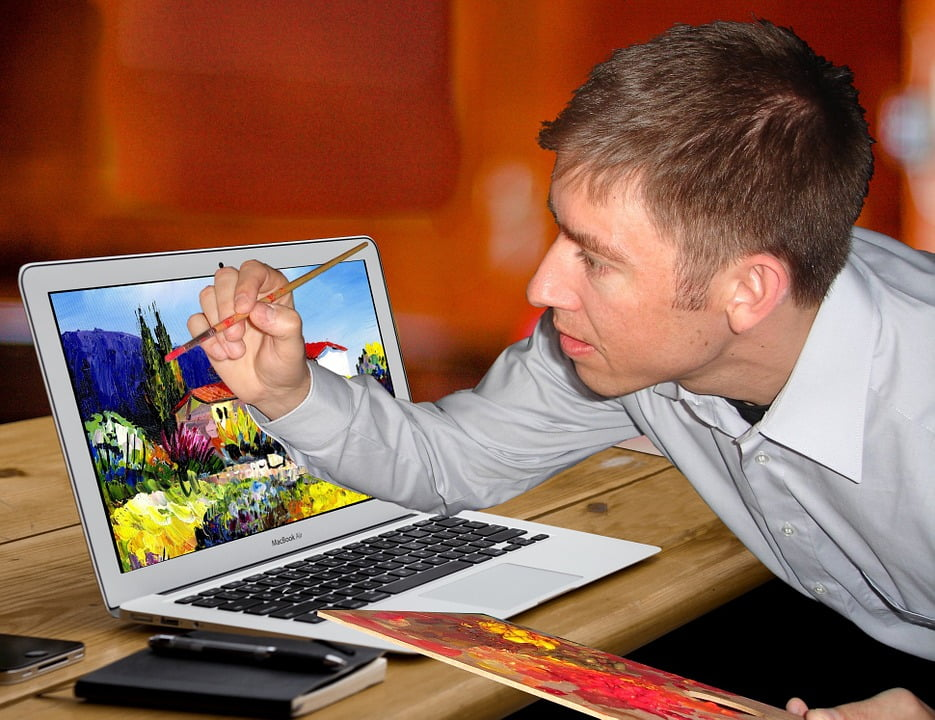 artist painting on laptop screen, Dentons Digital, Website Design Build, Wiltshire, Somerset