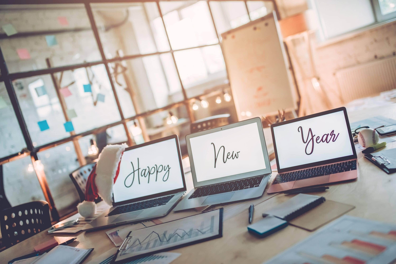 three laptops in office, Festive Marketing, Dentons Digital, Website Design, Wiltshire, Somerset