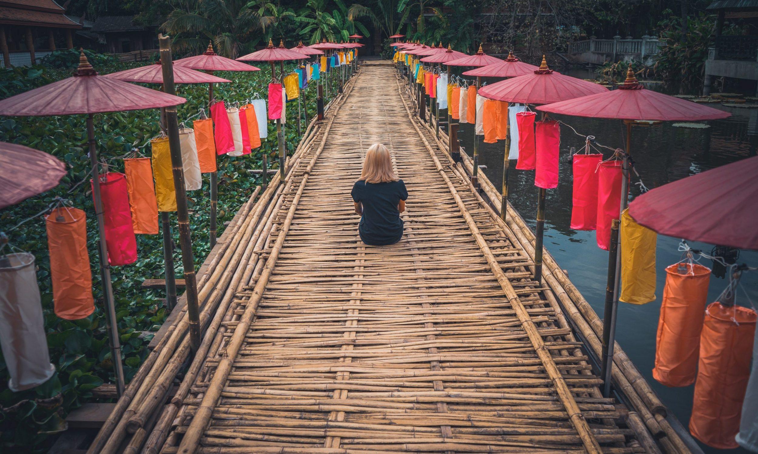 Woman sitting on bamboo dock, Dentons Digital, Website Design, Wiltshire, Somerset